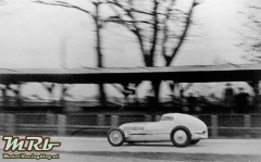 "Record run on the AVUS on December 10, 1934: Rudolf Caracciola driving the Mercedes-Benz W 25 record car, called ""racing sedan"" by him."